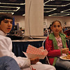 Daniel Wiggins and his sister waiting for the direct elimination round to start in the Youth-14 Men's Epee event.  Someone stole (and ate) Daniels Subway sandwich so he had to get something from the convention center restaurant.