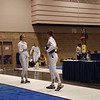 Katharine Holmes checks guards before fencing Lindsey Campbell in the direct elimination of the Division I Women's Epee.