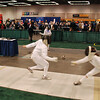 Elizabeth Wiggins (right) in the direct elimination round of the Youth-10 Women's Epee.