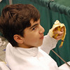 Daniel Wiggins snacks on a banana during the Youth-14 Men's Epee.