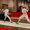 Katharine Holmes (right) fences in the direct elimination round of the Youth-14 Women's Epee.