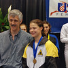 Katharine Holmes receives the gold medal in Youth-14 Women's Epee from former Olympian Robert Marx.