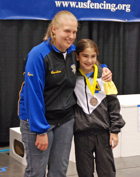 Elizabeth Wiggins receives the 5th place medal in the Youth-10 Women's Epee.