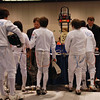 Seth Flanagan (right) in the pool huddle before the Youth-12 Men's Epee.