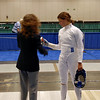 The referee checks Katharine Holmes' epee in the Division I Women's Epee.