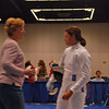 Coach Jean Finkleman speaks to Katharine Holmes during the direct elimination of the Division I Women's Epee.