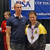 Katharine Holmes receives the 3rd place medal in the Division I Women's Epee National Championships from former Olympian Cody Mattern.