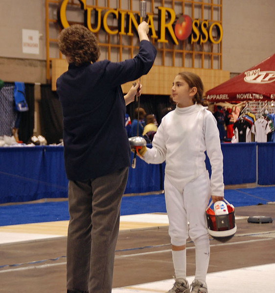 Referee checks Elizabeth Wiggins' epee in the Youth-10 Women's Epee.
