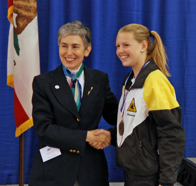 Channing Foster receiving her medal for seventh place in Youth-14 Women's Epee.
