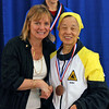 Bettie Graham receives the 5th place medal in Veteran-60 Women's Foil.