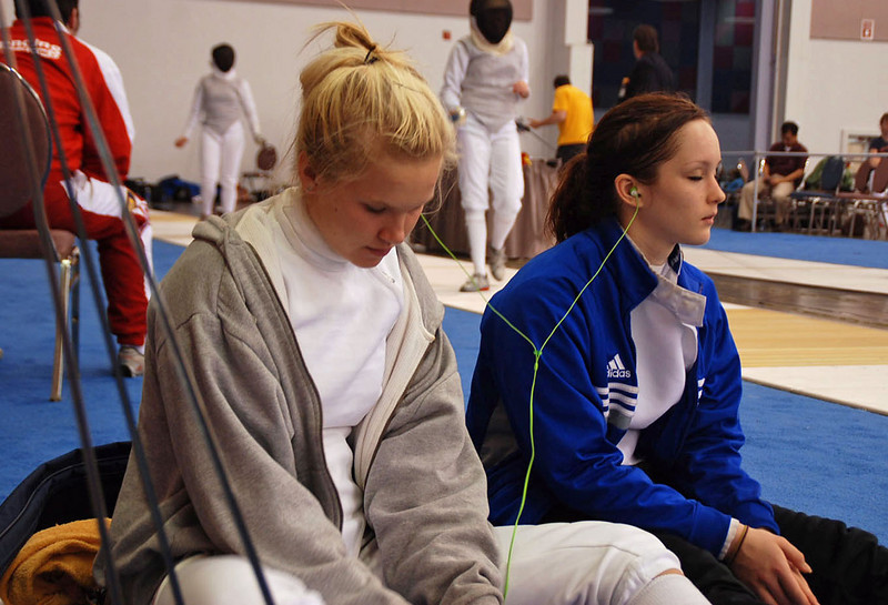Annie Stephenson and Lydia Kopecky share an iPod before the Division IA Women's Epee.