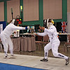 Bettie Graham scores a touch against Diane Kallus in the Veteran-60 Women's Epee.