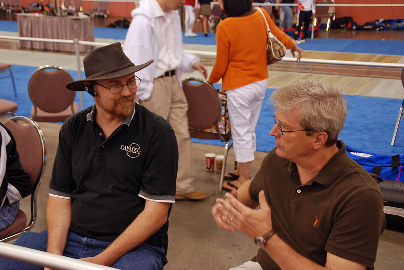 Brian Stephenson, right, talking with another fencing parent.