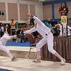 Elizabeth Wiggins, left, in the Youth-12 Women's Epee.