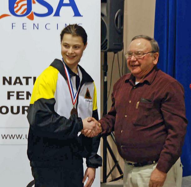 Buzz Hurst awards the gold medal to Katharine Holmes.