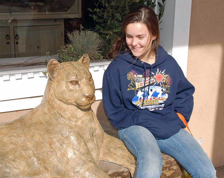Nina Moiseiwitsch takes a chance sitting by a mountain lion in Santa Fe, NM.