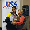 Katharine Holmes receives her gold medal in Cadet Women's Epee from Nancy Anderson.