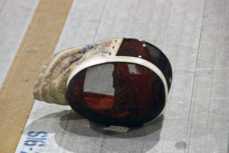 Fencing mask (not a helmet).
