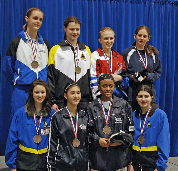 The finalists in Cadet Women's Epee.  From left, top row: Grace Neveu (3rd), Katharine Holmes (1st), Oksana Samorodov (2nd), Kathryn Bernstein (3rd); bottom row: Jessica O'Neill (7th), Nik Nik Ameli (5th), Kimberly Howell (6th), Victoria Wines (8th).