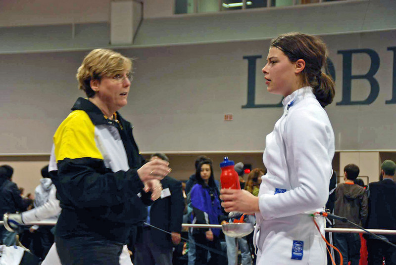 Coach Jean Finkleman talks with Katharine Holmes during the 1-minute break.