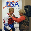 Oksana Samorodov receives her 5th place medal in Cadet Women's Epee from Nancy Anderson.