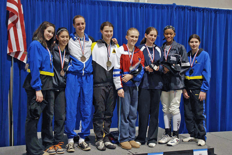 The finalists in Cadet Women's Epee.  From left: Jessica O'Neill (7th), Nik Nik Ameli (5th), Grace Neveu (3rd), Katharine Holmes (1st), Oksana Samorodov (2nd), Kathryn Bernstein (3rd), Kimberly Howell (6th), Victoria Wines (8th).
