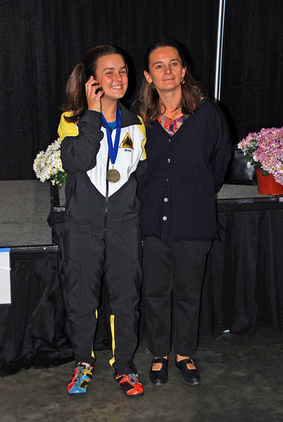Nina Moiseiwitsch, 1st Place, Division III Women's Epee, with her mom, Francoise and her father Julian (on the phone).