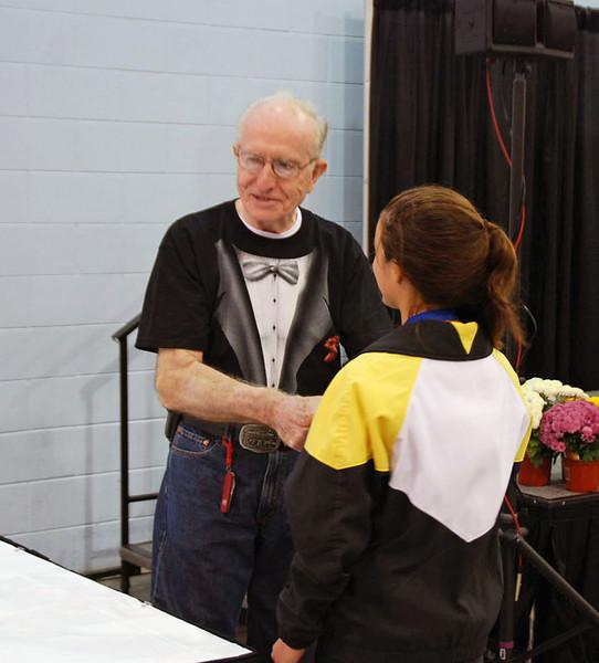 Joe Byrnes awarding Nina Moiseiwitsch her gold medal.