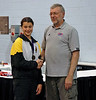 Katharine Holmes receiving her 6th place medal in Cadet Women's Epee from George Masin.