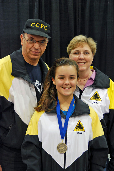 Nina Moiseiwitsch, 1st Place, Division III Women's Epee, with her coaches Raymond Finkleman and Jean Finkleman.