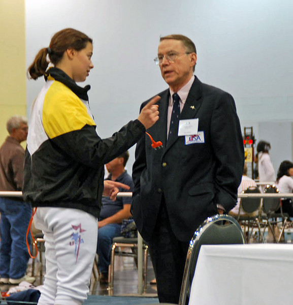 Katharine Holmes confering with referee Jim Adams, Chair of Capitol Division.