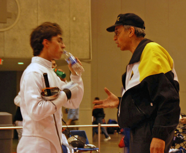 Ben Cohen coached during the 1-minute break in the direct elimination by his fencing master Raymond Finkleman.