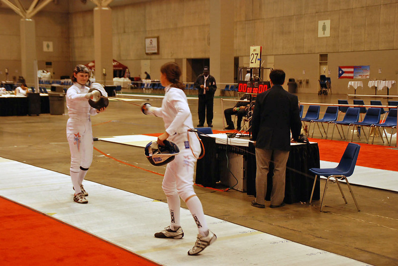 Katharine Holmes tests guards with Juleah Nusz in the gold medal bout of the Cadet Women's Epee