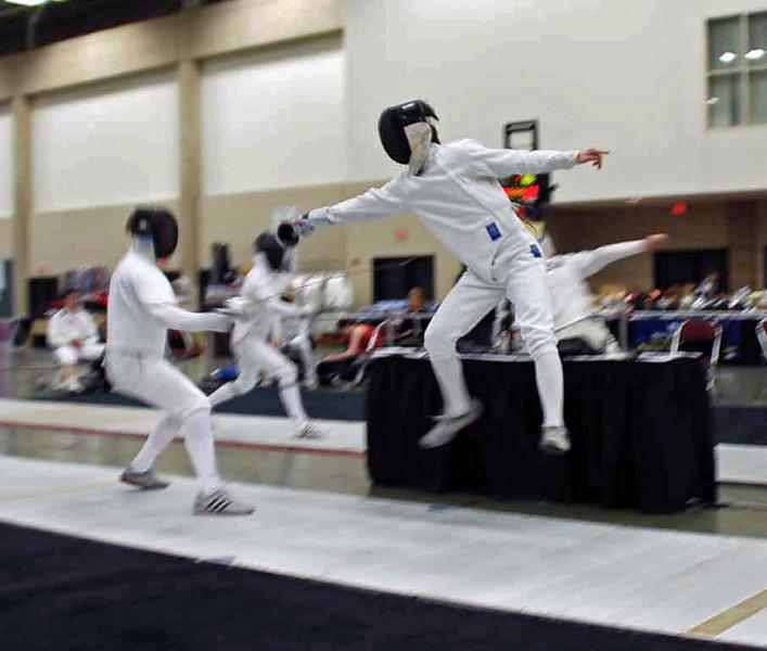 Ben Cohen scores a touch with a vertical leap.