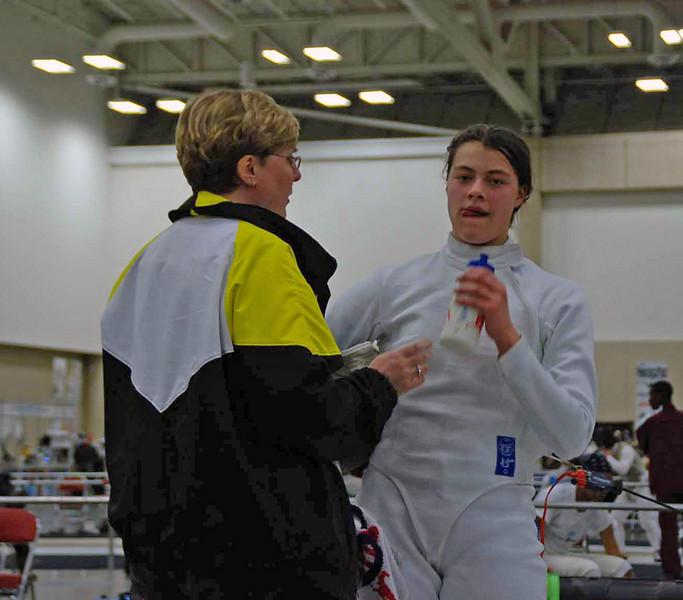 Coach Jean Finkleman talks to Katharine Holmes during the 1-minute break.