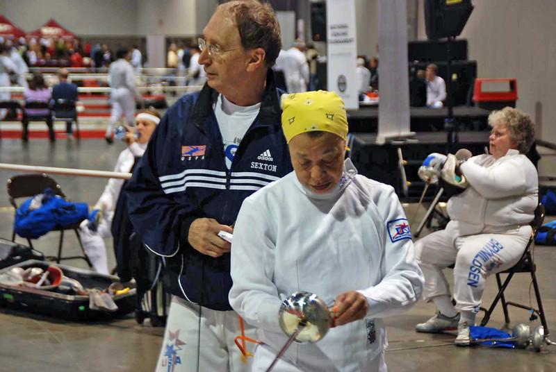 Ray Sexton helps hook up Bettie Graham in the Veteran 60+ Women's Epee.