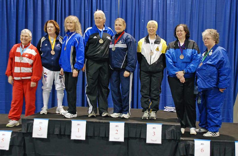 The finalists in Veteran 60+ Women's Epee.  From left: Terry Abrahams (7th), Diane Reckling (5th), Patricia Lutton (3rd), Cynthia Runyon (1st), Diane Kallus (2nd), Bettie Graham (3rd), Sandra Schwartz (6th), Karen Brynildsen (8th).