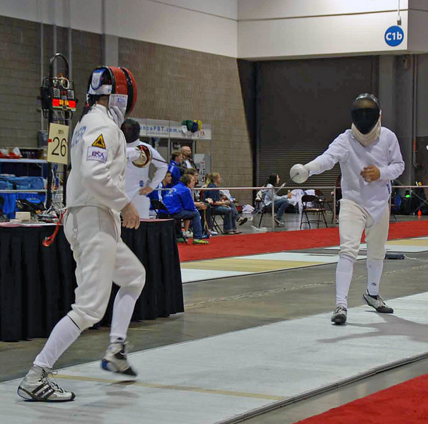 Lewis Sloter (left) in the Division II Men's Epee.