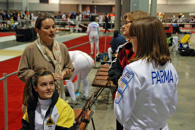 Nina Moiseiwitsch (seated) and her mom talk to friends Natalie Parma and her mom.