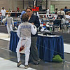 The referee inspects Raphael Sitbon-Taylor's foil in the Y10 Men's Foil.