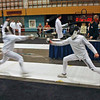 Seth Flanagan, left, in the Y12 Men's Epee.