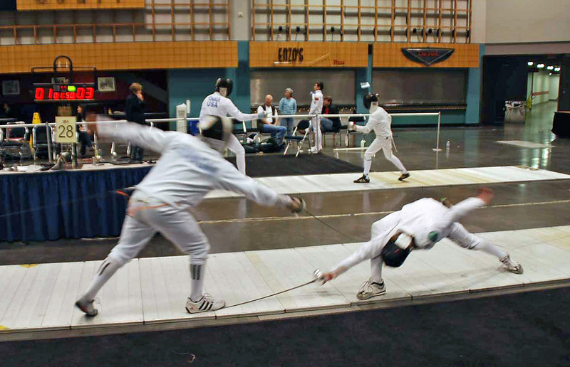 Seth Flanagan, left, gets hit on the toe in the Y12 Men's Epee.