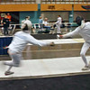 Seth Flanagan, left, fleches in the Y12 Men's Epee.