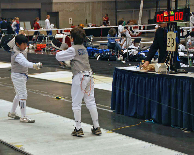 Raphael Sitbon-Taylor (right) checks the vest of his opponent in the Y10 Men's Foil.