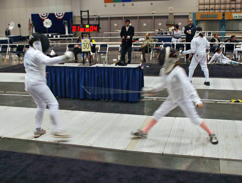Lizzie Wiggins, right, in the Y10 Women's Epee.