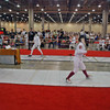 Ella Barnes scores the winning touch in the U16 Women's Epee.