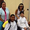 Seth Flanagan and Daniel Wiggins before the Y14 Men's Epee with their moms.