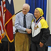 Bettie Graham receives the 3rd place medal in Veteran-60+ Women's Epee.