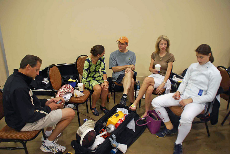 Katharine Holmes relaxes after pools of the Division I Women's Epee.  From left: Chris Holmes, Francoise Moiseiwitsch, Brian Stephenson, Lorrie Holmes, Katharine Holmes.
