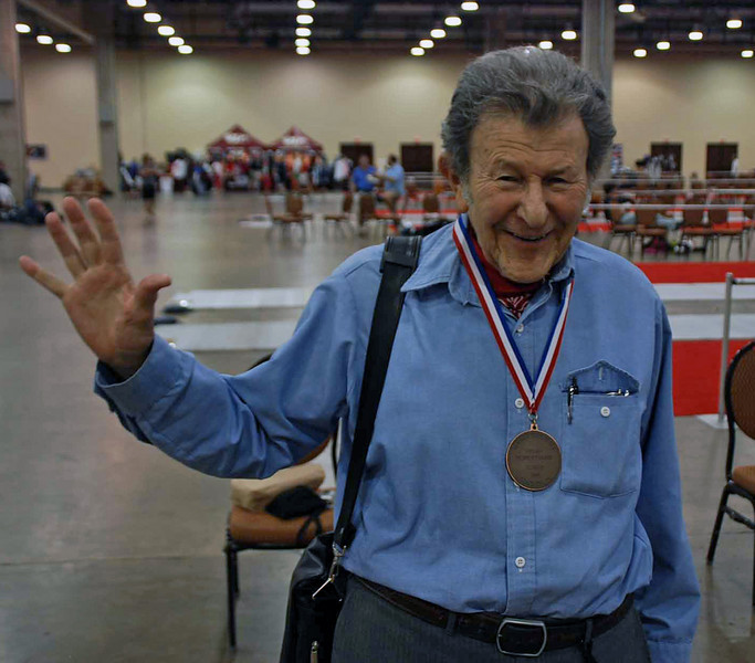 Herb Spector says hi to the fencers back in Capitol Division.  He fenced in the Veteran-70+ Men's Sabre, placing 3rd.